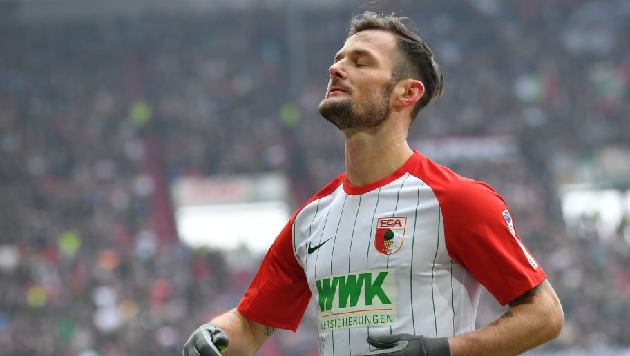 AUGSBURG, GERMANY - MARCH 03: Marcel Heller of Augsburg reacts after a missed chance during the Bundesliga match between FC Augsburg and TSG 1899 Hoffenheim at WWK-Arena on March 3, 2018 in Augsburg, Germany. (Photo by Sebastian Widmann/Bongarts/Getty Images)