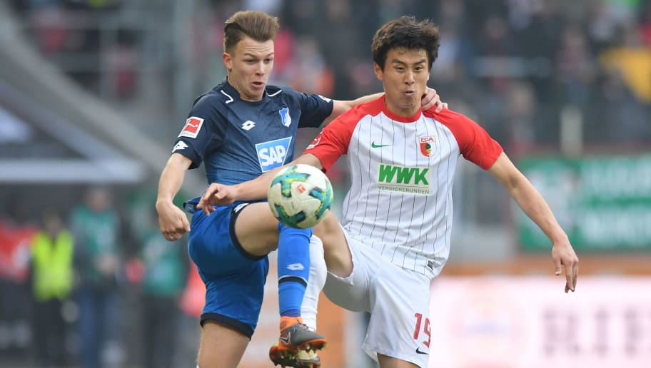 AUGSBURG, GERMANY - MARCH 03: Dennis Geiger of Hoffenheim and Ja-Cheol Koo of Augsburg compete for the ball during the Bundesliga match between FC Augsburg and TSG 1899 Hoffenheim at WWK-Arena on March 3, 2018 in Augsburg, Germany. (Photo by Sebastian Widmann/Bongarts/Getty Images)