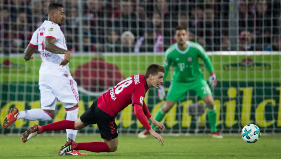 FREIBURG IM BREISGAU, GERMANY - MARCH 04: Nils Petersen of Freiburg is fouled by Jerome Boateng of Muenchen during the Bundesliga match between Sport-Club Freiburg and FC Bayern Muenchen at Schwarzwald-Stadion on March 4, 2018 in Freiburg im Breisgau, Germany. (Photo by Simon Hofmann/Bongarts/Getty Images)