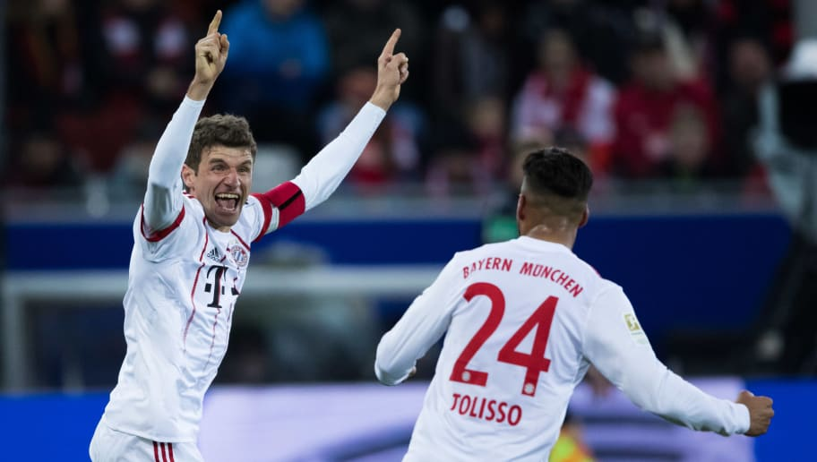 FREIBURG IM BREISGAU, GERMANY - MARCH 04: Thomas Mueller of Muenchen celebrates his team's first goal with team mate Corentin Tolisso during the Bundesliga match between Sport-Club Freiburg and FC Bayern Muenchen at Schwarzwald-Stadion on March 4, 2018 in Freiburg im Breisgau, Germany. (Photo by Simon Hofmann/Bongarts/Getty Images)