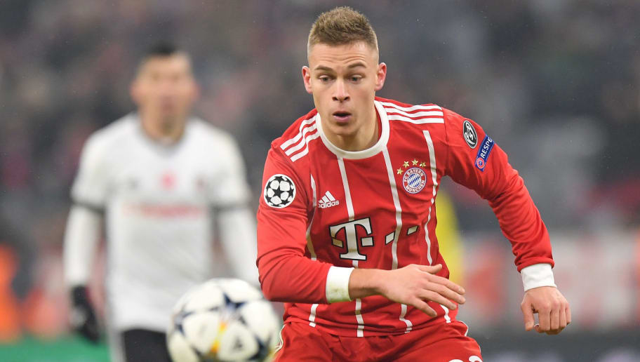 MUNICH, GERMANY - FEBRUARY 20: Joshua Kimmich of Bayern Muenchen plays the ball during the UEFA Champions League Round of 16 First Leg match between Bayern Muenchen and Besiktas at Allianz Arena on February 20, 2018 in Munich, Germany. (Photo by Sebastian Widmann/Bongarts/Getty Images)