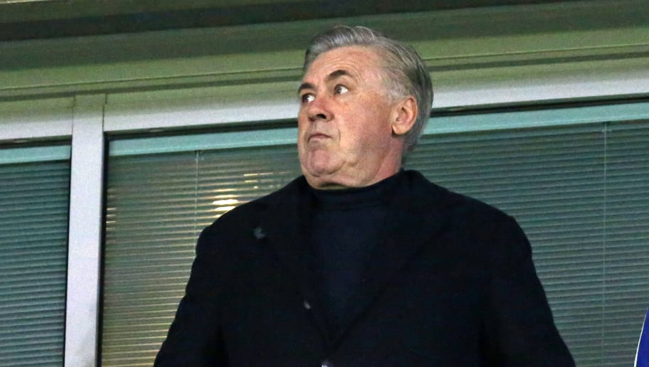 Former Chelsea manager Carlo Ancelotti takes his seat for the first leg of the UEFA Champions League round of 16 football match between Chelsea and Barcelona at Stamford Bridge stadium in London on February 20, 2018. / AFP PHOTO / IKIMAGES / Ian KINGTON        (Photo credit should read IAN KINGTON/AFP/Getty Images)