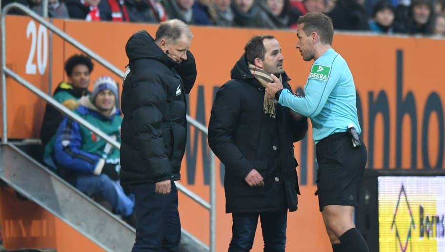 AUGSBURG, GERMANY - FEBRUARY 18: Stefan Reuter (l-r) and head coach Manuel Baum of Augsburg argue with referee Tobias Stieler during the Bundesliga match between FC Augsburg and VfB Stuttgart at WWK-Arena on February 18, 2018 in Augsburg, Germany. (Photo by Sebastian Widmann/Bongarts/Getty Images)