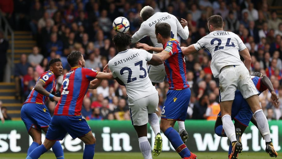 Chelsea's French midfielder Tiemoue Bakayoko (2nd R) jumps to haed Chelsea's first goal during the English Premier League football match between Crystal Palace and Chelsea at Selhurst Park in south London on October 14, 2017 / AFP PHOTO / Ian KINGTON / RESTRICTED TO EDITORIAL USE. No use with unauthorized audio, video, data, fixture lists, club/league logos or 'live' services. Online in-match use limited to 75 images, no video emulation. No use in betting, games or single club/league/player publications.  /         (Photo credit should read IAN KINGTON/AFP/Getty Images)