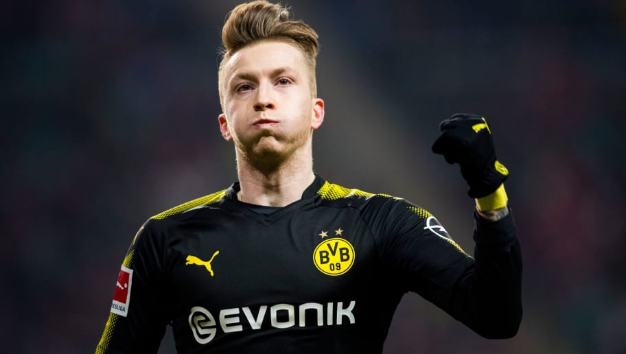 Dortmund´s midfielder Marco Reus celebrates scoring during the German first division Bundesliga football match RB Leipzig vs Borussia Dortmund in Leipzig, eastern Germany, on March 3, 2018. / AFP PHOTO / ROBERT MICHAEL / RESTRICTIONS: DURING MATCH TIME: DFL RULES TO LIMIT THE ONLINE USAGE TO 15 PICTURES PER MATCH AND FORBID IMAGE SEQUENCES TO SIMULATE VIDEO. == RESTRICTED TO EDITORIAL USE == FOR FURTHER QUERIES PLEASE CONTACT DFL DIRECTLY AT + 49 69 650050         (Photo credit should read ROBERT MICHAEL/AFP/Getty Images)