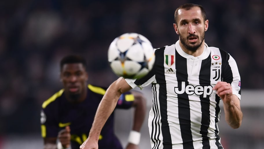 Juventus' defender from Italy Giorgio Chiellini watches the ball during the UEFA Champions League round of sixteen first leg football match between Juventus and Tottenham Hotspur at The Allianz Stadium in Turin on February 13, 2018.  / AFP PHOTO / Marco BERTORELLO        (Photo credit should read MARCO BERTORELLO/AFP/Getty Images)