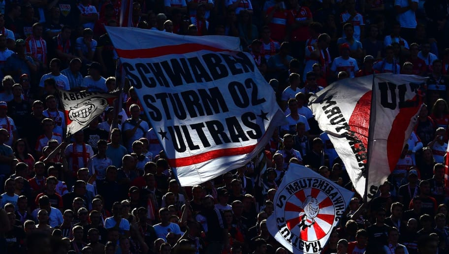 Supporters of VfB Stuttgart wave banners during the German First division Bundesliga football match Hertha Berlin vs VfB Stuttgart in Berlin, on August 19, 2017. / AFP PHOTO / Tobias SCHWARZ / RESTRICTIONS: DURING MATCH TIME: DFL RULES TO LIMIT THE ONLINE USAGE TO 15 PICTURES PER MATCH AND FORBID IMAGE SEQUENCES TO SIMULATE VIDEO. == RESTRICTED TO EDITORIAL USE == FOR FURTHER QUERIES PLEASE CONTACT DFL DIRECTLY AT + 49 69 650050         (Photo credit should read TOBIAS SCHWARZ/AFP/Getty Images)