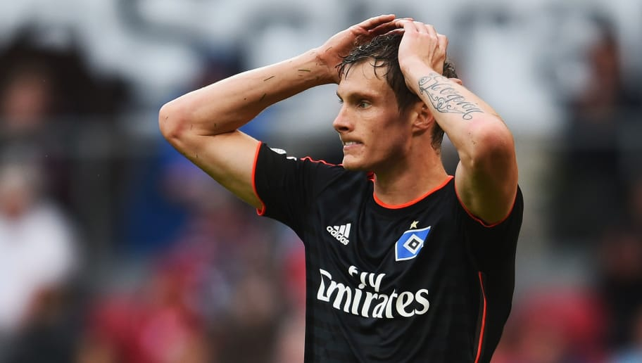 COLOGNE, GERMANY - AUGUST 23:  Marcell Jansen of Hamburger SV reacts during the Bundesliga match between 1. FC Koeln and Hamburger SV at RheinEnergieStadion on August 23, 2014 in Cologne, Germany.  (Photo by Dennis Grombkowski/Bongarts/Getty Images)