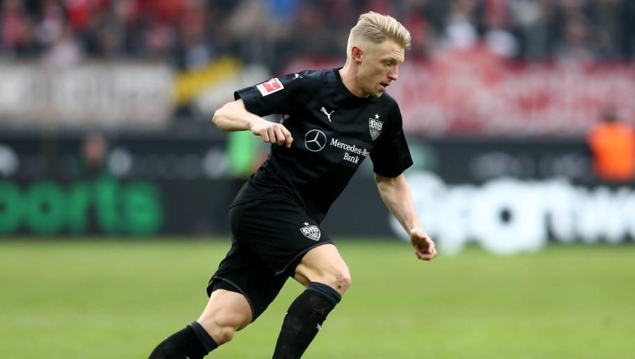 COLOGNE, GERMANY - MARCH 04: Andreas Beck of Stuttgart runs with the ball during the Bundesliga match between 1. FC Koeln and VfB Stuttgart at RheinEnergieStadion on March 4, 2018 in Cologne, Germany. The match between Koeln and Stuttgart ended 2-3. (Photo by Christof Koepsel/Bongarts/Getty Images)
