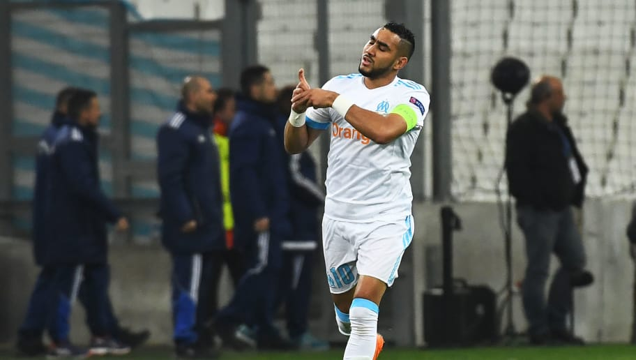 Olympique de Marseille's French forward Dimitri Payet celebrates with teammates after scoring during the UEFA Europa League football match between Marseille and Atletic Bilbao on March 8, 2018 at the 'Velodrome' stadium in Marseille, southern France.  / AFP PHOTO / ANNE-CHRISTINE POUJOULAT        (Photo credit should read ANNE-CHRISTINE POUJOULAT/AFP/Getty Images)