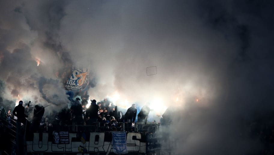 MAINZ, GERMANY - MARCH 09: Fans of Schalke burn flares during the Bundesliga match between 1. FSV Mainz 05 and FC Schalke 04 at Opel Arena on March 9, 2018 in Mainz, Germany.  (Photo by Alex Grimm/Bongarts/Getty Images)