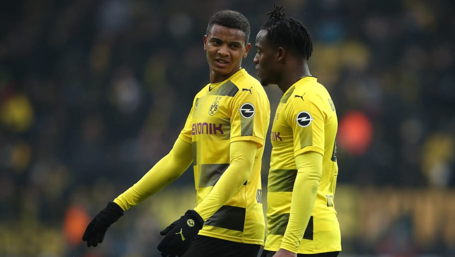 DORTMUND, GERMANY - FEBRUARY 10: Manuel Akanji of Dortmund (l) talks with Michy Batshuayi of Dortmund during the Bundesliga match between Borussia Dortmund and Hamburger SV at Signal Iduna Park on February 10, 2018 in Dortmund, Germany. (Photo by Oliver Hardt/Bongarts/Getty Images)