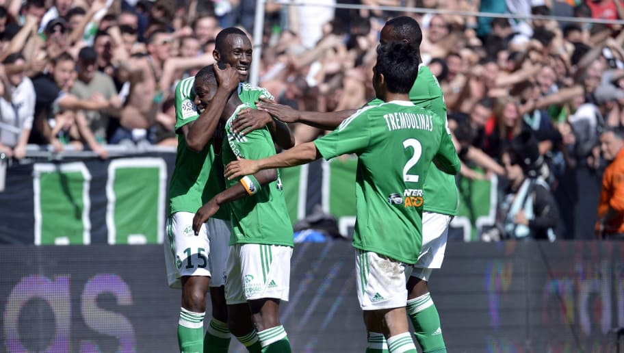 St Etienne's Ivorian forward Max-Alain Gradel (2ndL) is congratulated by his teammates Josuha Guilavogui (L) after scoring a goal  during the French L1 football match Saint-Etienne (ASSE) vs Nice (OGC) on April 6, 2014 at the Geoffroy-Guichard stadium in Saint-Etienne.  AFP PHOTO PHILIPPE MERLE        (Photo credit should read PHILIPPE MERLE/AFP/Getty Images)