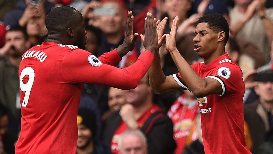 Manchester United's English striker Marcus Rashford (R) celebrates scoring the opening goal with Manchester United's Belgian striker Romelu Lukaku (L) during the English Premier League football match between Manchester United and Liverpool at Old Trafford in Manchester, north west England, on March 10, 2018. / AFP PHOTO / Oli SCARFF / RESTRICTED TO EDITORIAL USE. No use with unauthorized audio, video, data, fixture lists, club/league logos or 'live' services. Online in-match use limited to 75 images, no video emulation. No use in betting, games or single club/league/player publications.  /         (Photo credit should read OLI SCARFF/AFP/Getty Images)
