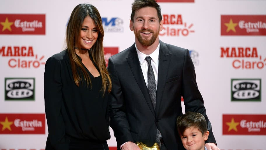 Barcelona's Argentinian forward Lionel Messi poses his wife Antonella Roccuzzo and their son Thiago after receiving the 2017 European Golden Shoe honoring the year's leading goalscorer during a ceremony at the Antigua Fabrica Estrella Damm in Barcelona on November 24, 2017. / AFP PHOTO / Josep LAGO        (Photo credit should read JOSEP LAGO/AFP/Getty Images)