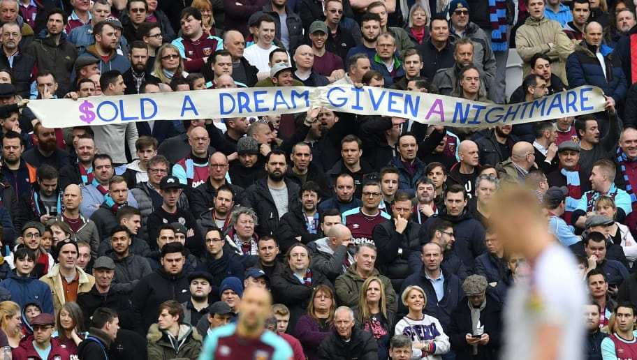 West Ham fans hold up a banner during the English Premier League football match between West Ham United and Burnley at The London Stadium, in east London on March 10, 2018. / AFP PHOTO / Ben STANSALL / RESTRICTED TO EDITORIAL USE. No use with unauthorized audio, video, data, fixture lists, club/league logos or 'live' services. Online in-match use limited to 75 images, no video emulation. No use in betting, games or single club/league/player publications.  /         (Photo credit should read BEN STANSALL/AFP/Getty Images)
