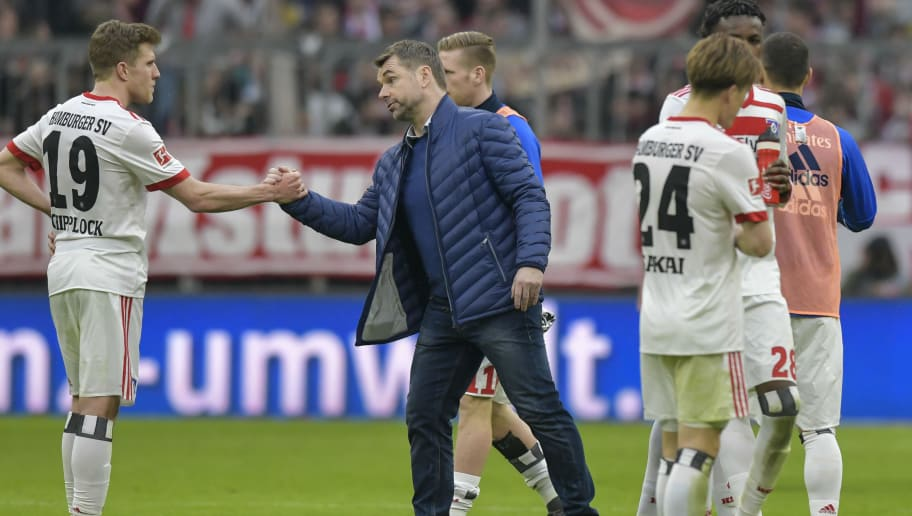 Hamburg's German coach Bernd Hollerbach thanks Hamburg's German forward Sven Schipplock after the German first division Bundesliga football match Bayern Munich vs Hamburger SV in Munich on March 10, 2018. / AFP PHOTO / Guenter SCHIFFMANN / RESTRICTIONS: DURING MATCH TIME: DFL RULES TO LIMIT THE ONLINE USAGE TO 15 PICTURES PER MATCH AND FORBID IMAGE SEQUENCES TO SIMULATE VIDEO. == RESTRICTED TO EDITORIAL USE == FOR FURTHER QUERIES PLEASE CONTACT DFL DIRECTLY AT + 49 69 650050         (Photo credit should read GUENTER SCHIFFMANN/AFP/Getty Images)