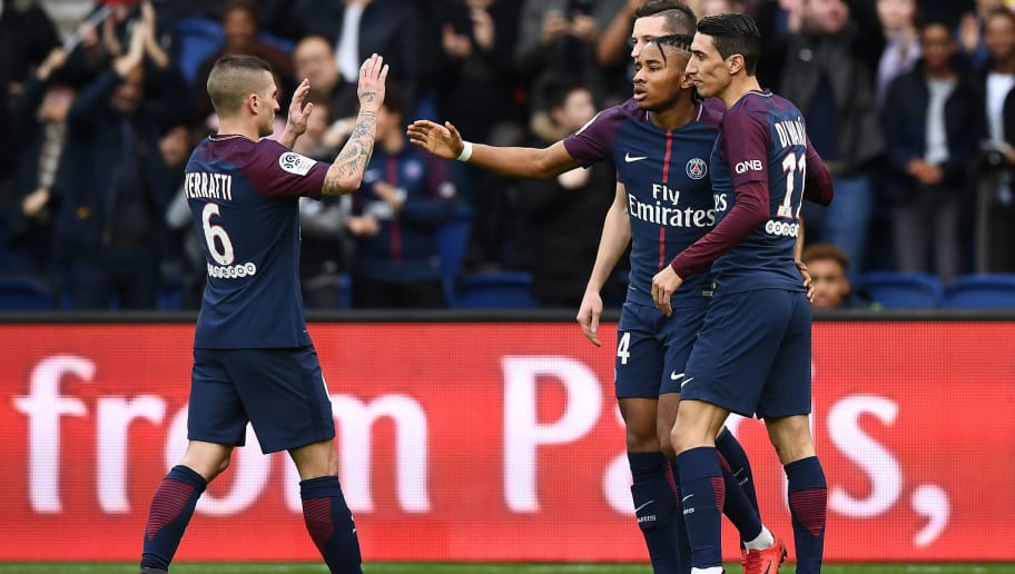 Paris Saint-Germain's French midfielder Christopher Nkunku (C) is congratuled by teammates after scoring a goal during the French Ligue 1 football match between Paris Saint-Germain and Metz at the Parc des Princes stadium in Paris on March 10, 2018. / AFP PHOTO / FRANCK FIFE        (Photo credit should read FRANCK FIFE/AFP/Getty Images)