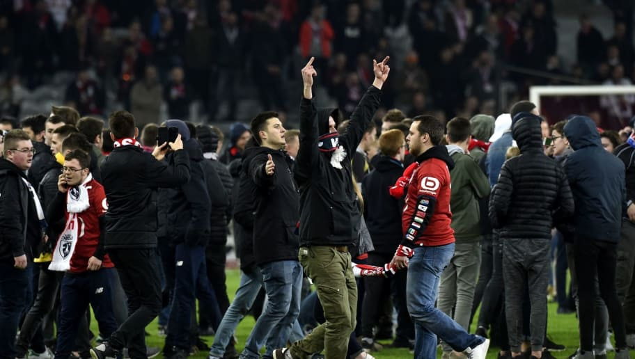 Lille's supporters invade the pitch  at the end of the French L1 football match between Lille (LOSC) and Montpellier (MHSC) on March 10, 2018, at the Pierre Mauroy Stadium in Lille, northern France. / AFP PHOTO / FRANCOIS LO PRESTI        (Photo credit should read FRANCOIS LO PRESTI/AFP/Getty Images)