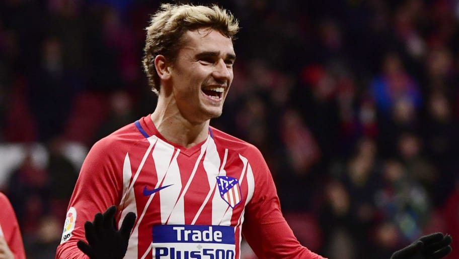 TOPSHOT - Atletico Madrid's French forward Antoine Griezmann (R) celebrates his fourth goal during the Spanish league football match Club Atletico de Madrid against Club Deportivo Leganes SAD at the Wanda Metropolitano stadium in Madrid on February 28, 2018. / AFP PHOTO / PIERRE-PHILIPPE MARCOU        (Photo credit should read PIERRE-PHILIPPE MARCOU/AFP/Getty Images)