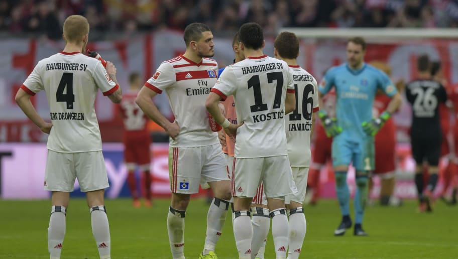 Hamburg's players react after the German first division Bundesliga football match Bayern Munich vs Hamburger SV in Munich on March 10, 2018. / AFP PHOTO / Guenter SCHIFFMANN / RESTRICTIONS: DURING MATCH TIME: DFL RULES TO LIMIT THE ONLINE USAGE TO 15 PICTURES PER MATCH AND FORBID IMAGE SEQUENCES TO SIMULATE VIDEO. == RESTRICTED TO EDITORIAL USE == FOR FURTHER QUERIES PLEASE CONTACT DFL DIRECTLY AT + 49 69 650050         (Photo credit should read GUENTER SCHIFFMANN/AFP/Getty Images)