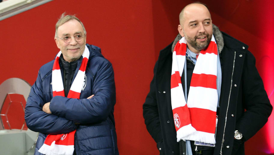 Lille's outgoing president Michel Seydoux (L) enters the field with  Lille's new president Gerard Lopez during the French L1 football match between Lille OSC (LOSC) and Saint Etienne on January  13, 2017 at the Pierre-Mauroy Stadium in Villeneuve d'Ascq, northern France.  / AFP / DENIS CHARLET        (Photo credit should read DENIS CHARLET/AFP/Getty Images)