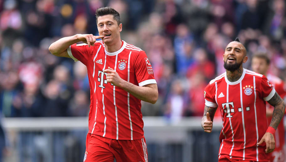 MUNICH, GERMANY - MARCH 10: Robert Lewandowski of Bayern Muenchen celebrates after he scored a goal to make it 2:0 during the Bundesliga match between FC Bayern Muenchen and Hamburger SV at Allianz Arena on March 10, 2018 in Munich, Germany. (Photo by Sebastian Widmann/Bongarts/Getty Images)