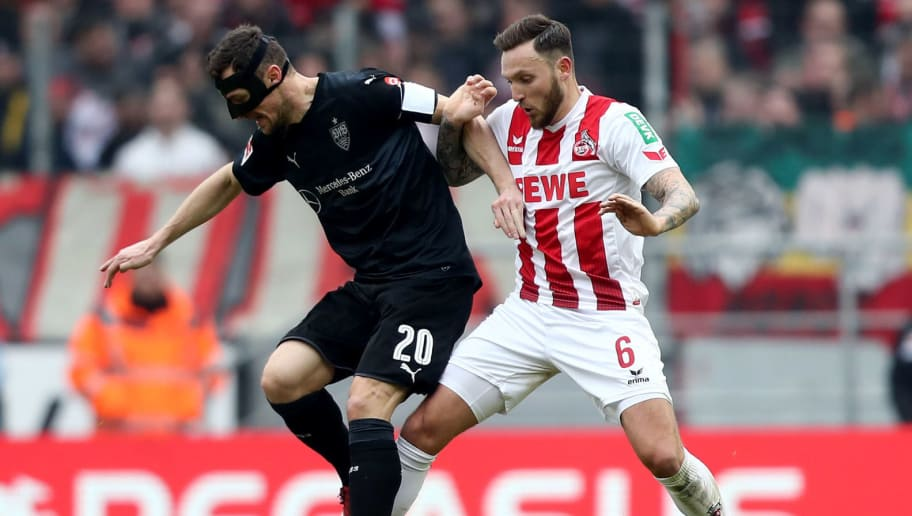 COLOGNE, GERMANY - MARCH 04:  Marco Hoeger of Koeln (R) challenges Christian Gentner of Stuttgart (L) during the Bundesliga match between 1. FC Koeln and VfB Stuttgart at RheinEnergieStadion on March 4, 2018 in Cologne, Germany. (Photo by Christof Koepsel/Bongarts/Getty Images)