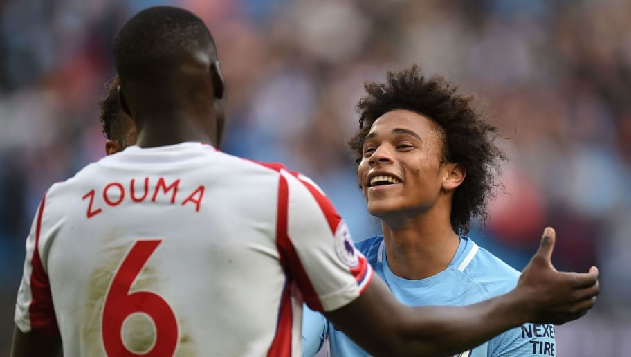Manchester City's German midfielder Leroy Sane (R) greets Stoke City's French defender Kurt Zouma (L) at the end of the English Premier League football match between Manchester City and Stoke City at the Etihad Stadium in Manchester, north west England, on October 14, 2017. / AFP PHOTO / Oli SCARFF / RESTRICTED TO EDITORIAL USE. No use with unauthorized audio, video, data, fixture lists, club/league logos or 'live' services. Online in-match use limited to 75 images, no video emulation. No use in betting, games or single club/league/player publications.  /         (Photo credit should read OLI SCARFF/AFP/Getty Images)