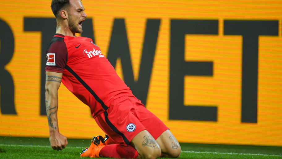 Frankfurt's German midfielder Danny Blum reacts after scoring during the German first division Bundesliga football match Borussia Dortmund vs Eintracht Frankfurt, in Dortmund, western Germany, on March 11, 2018. / AFP PHOTO / Patrik STOLLARZ / RESTRICTIONS: DURING MATCH TIME: DFL RULES TO LIMIT THE ONLINE USAGE TO 15 PICTURES PER MATCH AND FORBID IMAGE SEQUENCES TO SIMULATE VIDEO. == RESTRICTED TO EDITORIAL USE == FOR FURTHER QUERIES PLEASE CONTACT DFL DIRECTLY AT + 49 69 650050         (Photo credit should read PATRIK STOLLARZ/AFP/Getty Images)