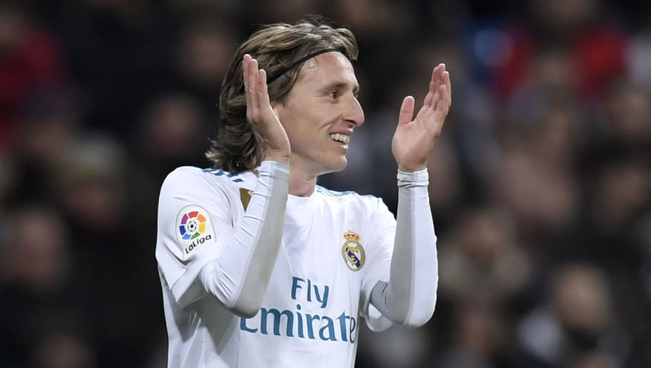 Real Madrid's Croatian midfielder Luka Modric applauds during the Spanish league football match between Real Madrid CF and Real Sociedad at the Santiago Bernabeu stadium in Madrid on February 10, 2018. / AFP PHOTO / GABRIEL BOUYS        (Photo credit should read GABRIEL BOUYS/AFP/Getty Images)