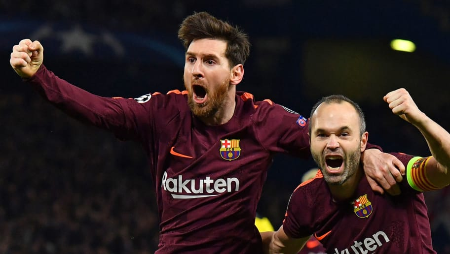 TOPSHOT - Barcelona's Argentinian striker Lionel Messi (L) celebrates with Barcelona's Spanish midfielder Andres Iniesta (R) after scoring their first goal during the first leg of the UEFA Champions League round of 16 football match between Chelsea and Barcelona at Stamford Bridge stadium in London on February 20, 2018. / AFP PHOTO / Ben STANSALL        (Photo credit should read BEN STANSALL/AFP/Getty Images)