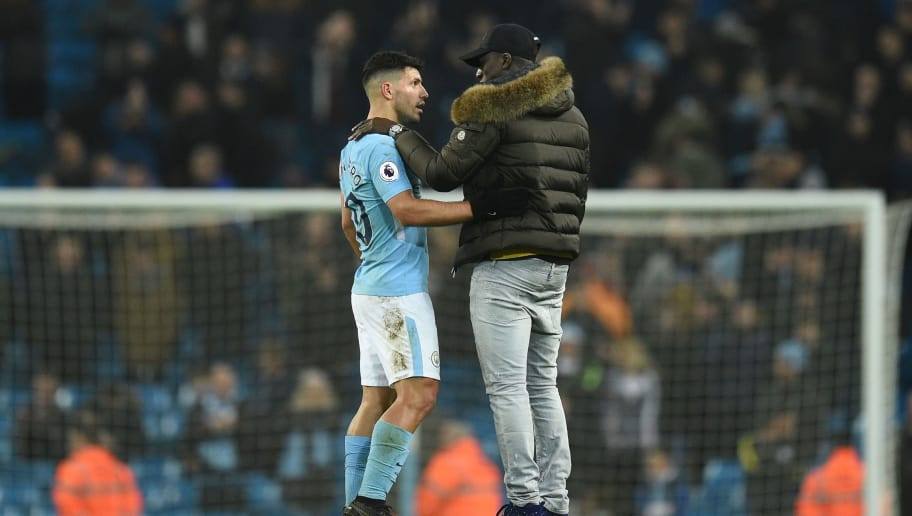 Manchester City's French defender Benjamin Mendy (R) talks with Manchester City's Argentinian striker Sergio Aguero (L) at the end of the English Premier League football match between Manchester City and Bournemouth at the Etihad Stadium in Manchester, north west England, on December 23, 2017. / AFP PHOTO / Oli SCARFF / RESTRICTED TO EDITORIAL USE. No use with unauthorized audio, video, data, fixture lists, club/league logos or 'live' services. Online in-match use limited to 75 images, no video emulation. No use in betting, games or single club/league/player publications.  /         (Photo credit should read OLI SCARFF/AFP/Getty Images)
