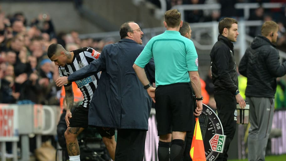 NEWCASTLE UPON TYNE, ENGLAND - MARCH 10:   Rafael Benitez, Manager of Newcastle United greets Kenedy of Newcastle United as he is substituted off during the Premier League match between Newcastle United and Southampton at St. James Park on March 10, 2018 in Newcastle upon Tyne, England.  (Photo by Mark Runnacles/Getty Images)