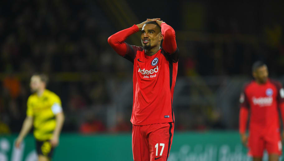 Frankfurt's Ghanaian midfielder Kevin-Prince Boateng reacts during the German first division Bundesliga football match Borussia Dortmund vs Eintracht Frankfurt, in Dortmund, western Germany, on March 11, 2018. / AFP PHOTO / Patrik STOLLARZ / RESTRICTIONS: DURING MATCH TIME: DFL RULES TO LIMIT THE ONLINE USAGE TO 15 PICTURES PER MATCH AND FORBID IMAGE SEQUENCES TO SIMULATE VIDEO. == RESTRICTED TO EDITORIAL USE == FOR FURTHER QUERIES PLEASE CONTACT DFL DIRECTLY AT + 49 69 650050         (Photo credit should read PATRIK STOLLARZ/AFP/Getty Images)