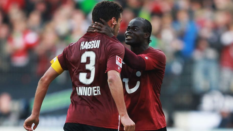 HANNOVER, GERMANY - SEPTEMBER 18:  Didier Ya Konan (R) and Karim Haggui of Hanover celebrate after the Bundesliga match between Hanover 96 and Borussia Dortmund at AWD Arena on September 18, 2011 in Hannover, Germany.  (Photo by Joern Pollex/Bongarts/Getty Images)