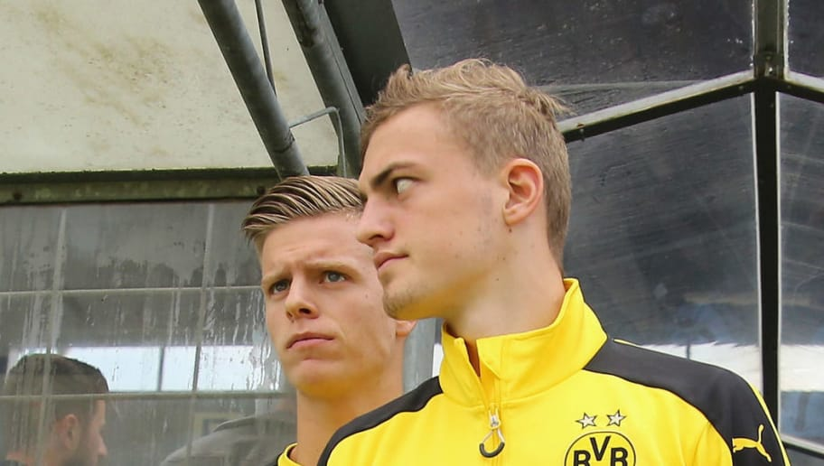 MUNICH, GERMANY - JULY 16:  (L-R) Dzenis Burnic and Jacob Bruun Larsen of Dortmund arrives for the friendly match between TSV 1860 Muenchen and BVB Borussia Dortmund at Stadion an der Gruenwalder Strasse on July 16, 2016 in Munich, Germany  (Photo by Johannes Simon/Bongarts/Getty Images)