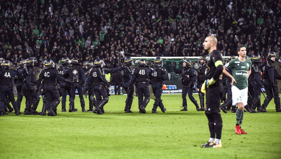 TOPSHOT - French riot police are seen on the pitch where Saint-Etienne fans descended during the French L1 football match between AS Saint-Etienne and Olympique Lyonnais, on November 5, 2017, at the Geoffroy Guichard stadium in Saint-Etienne, central France.    / AFP PHOTO / PHILIPPE DESMAZES        (Photo credit should read PHILIPPE DESMAZES/AFP/Getty Images)