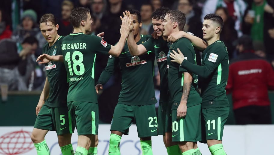 BREMEN, GERMANY - MARCH 12:  Milos Veljkovic (R) of Bremen celebrates his team's first goal with team mates during the Bundesliga match between SV Werder Bremen and 1. FC Koeln at Weserstadion on March 12, 2018 in Bremen, Germany.  (Photo by Lars Baron/Bongarts/Getty Images)