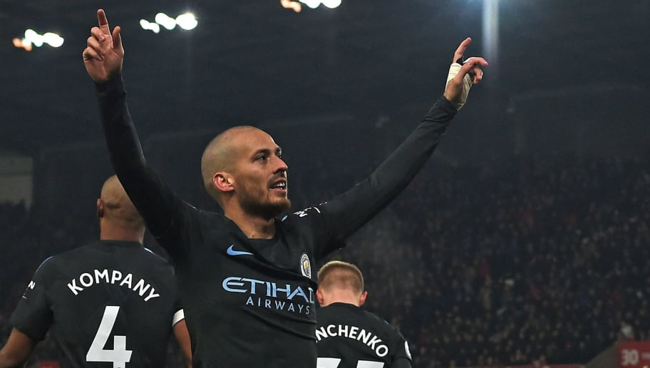 Manchester City's Spanish midfielder David Silva celebrates after scoring his second goal of the English Premier League football match between Stoke City and Manchester City at the Bet365 Stadium in Stoke-on-Trent, central England on March 12, 2018. / AFP PHOTO / PAUL ELLIS / RESTRICTED TO EDITORIAL USE. No use with unauthorized audio, video, data, fixture lists, club/league logos or 'live' services. Online in-match use limited to 75 images, no video emulation. No use in betting, games or single club/league/player publications.  /         (Photo credit should read PAUL ELLIS/AFP/Getty Images)