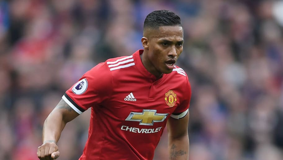 MANCHESTER, ENGLAND - MARCH 10:  Antonio Valencia of Manchester United runs with the ball during the Premier League match between Manchester United and Liverpool at Old Trafford on March 10, 2018 in Manchester, England.  (Photo by Laurence Griffiths/Getty Images)