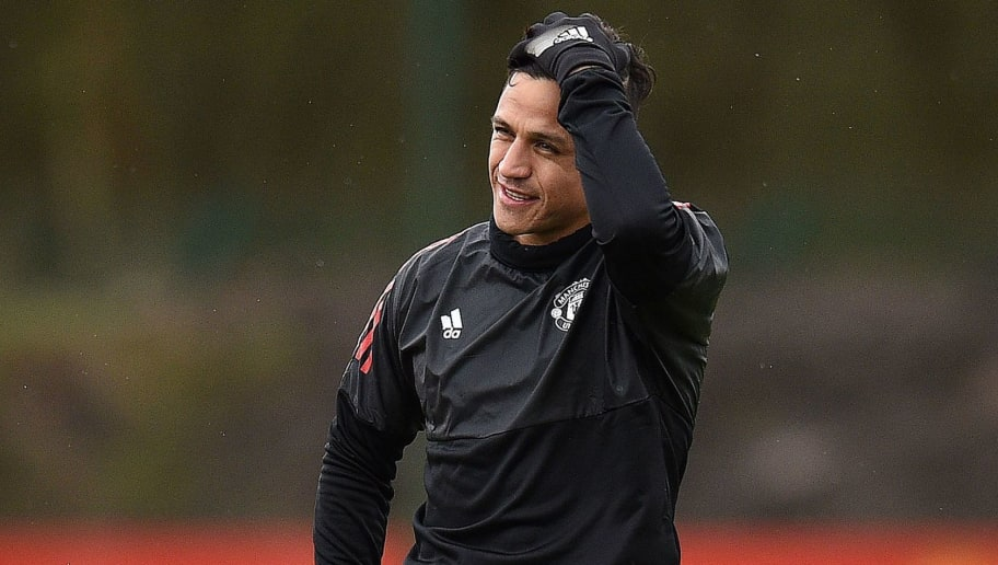 Manchester United's Chilean striker Alexis Sanchez attends a team training session at the club's training complex near Carrington, west of Manchester in north west England on March 12, 2018, on the eve of their UEFA Champions League round of 16 second-leg football match against Sevilla. / AFP PHOTO / Oli SCARFF        (Photo credit should read OLI SCARFF/AFP/Getty Images)