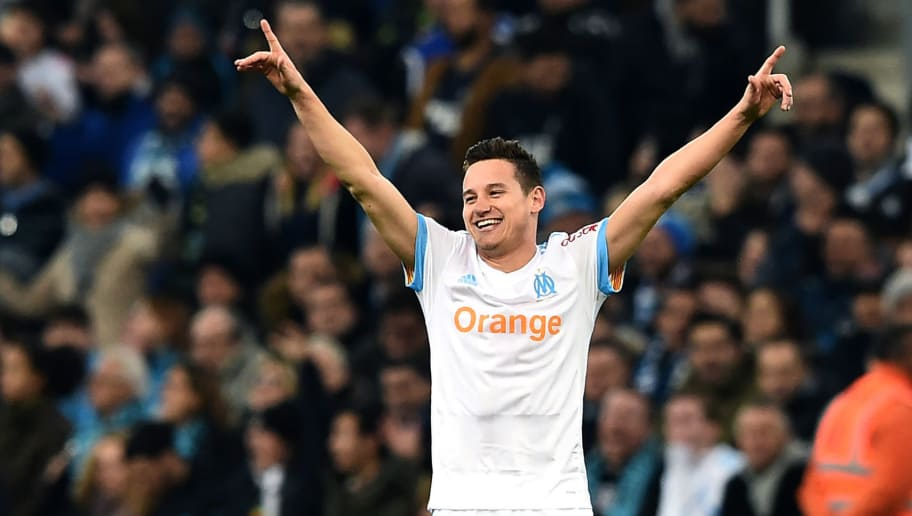 Olympique de Marseille's French midfielder Florian Thauvin celebrates after scoring a goal during the French L1 football match Marseille vs Bordeaux on February 18, 2018, at the Velodrome stadium in Marseille, Southern France. / AFP PHOTO / ANNE-CHRISTINE POUJOULAT        (Photo credit should read ANNE-CHRISTINE POUJOULAT/AFP/Getty Images)