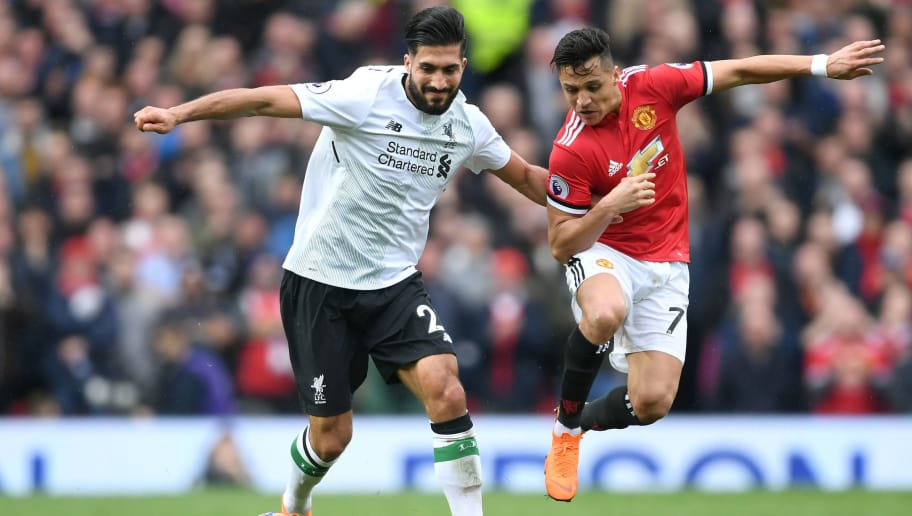 MANCHESTER, ENGLAND - MARCH 10:  Emre Can of Liverpool and Alexis Sanchez of Manchester United battle for the ball during the Premier League match between Manchester United and Liverpool at Old Trafford on March 10, 2018 in Manchester, England.  (Photo by Laurence Griffiths/Getty Images)