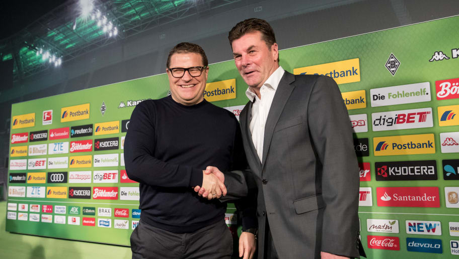 MOENCHENGLADBACH, GERMANY - JANUARY 04: Sport Director Max Eberl of Moenchengladbach (L) and Dieter Hecking, the newly appointed head coach of Borussia Moenchengladbach shake hands prior a press conference on January 4, 2017 in Moenchengladbach, Germany. (Photo by Maja Hitij/Bongarts/Getty Images)