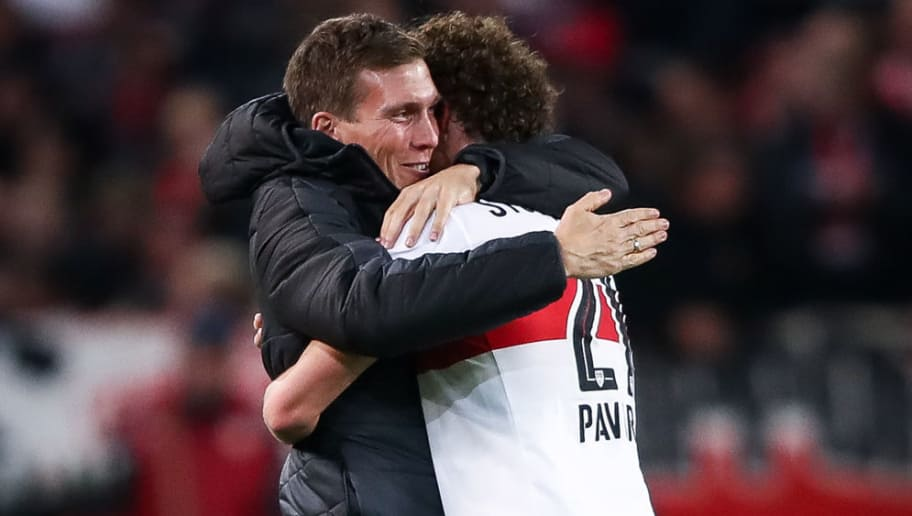 STUTTGART, GERMANY - OCTOBER 29: Benjamin Pavard #21 of Stuttgart celebrates with head coach of Stuttgart Hannes Wolf after scoring his team's second goal to make it 2-0 during the Bundesliga match between VfB Stuttgart and Sport-Club Freiburg at Mercedes-Benz Arena on October 29, 2017 in Stuttgart, Germany. (Photo by Alex Grimm/Bongarts/Getty Images)