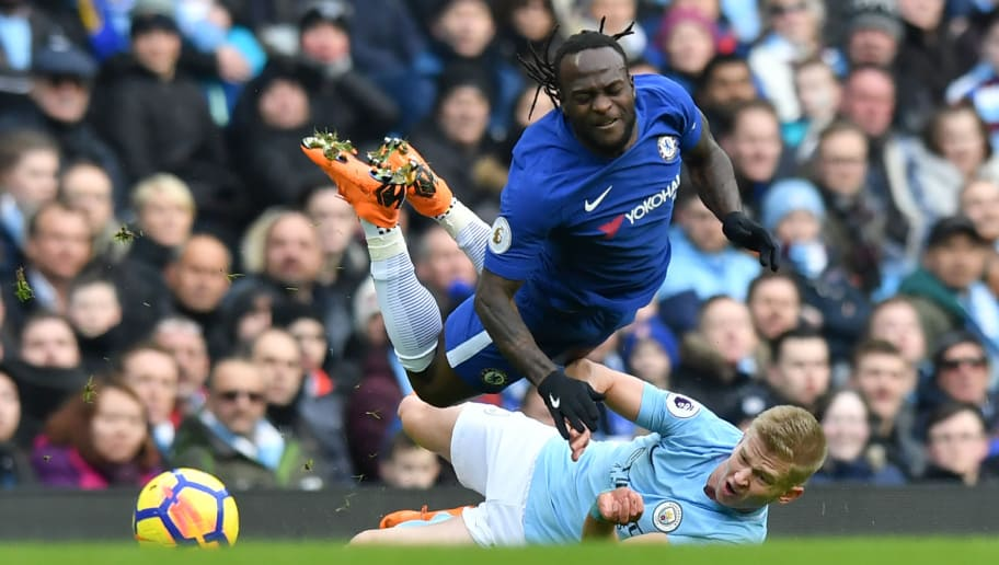 Chelsea's Nigerian midfielder Victor Moses (top) is tackled by Manchester City's Ukrainian midfielder Oleksandr Zinchenko during the English Premier League football match between Manchester City and Chelsea at the Etihad Stadium in Manchester, north west England on March 4, 2018. / AFP PHOTO / Anthony Devlin / RESTRICTED TO EDITORIAL USE. No use with unauthorized audio, video, data, fixture lists, club/league logos or 'live' services. Online in-match use limited to 75 images, no video emulation. No use in betting, games or single club/league/player publications.  /         (Photo credit should read ANTHONY DEVLIN/AFP/Getty Images)