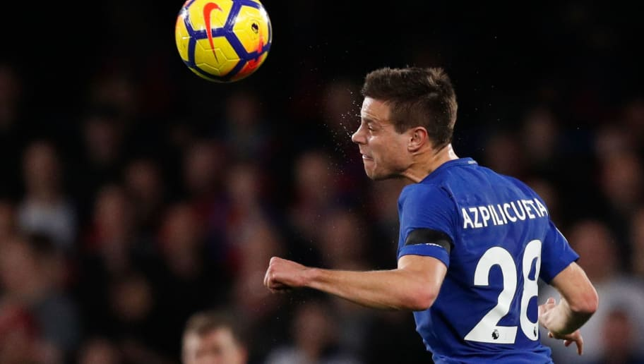Chelsea's Spanish defender Cesar Azpilicueta heads the ball during the English Premier League football match between Chelsea and Crystal Palace at Stamford Bridge in London on March 10, 2018. / AFP PHOTO / Adrian DENNIS / RESTRICTED TO EDITORIAL USE. No use with unauthorized audio, video, data, fixture lists, club/league logos or 'live' services. Online in-match use limited to 75 images, no video emulation. No use in betting, games or single club/league/player publications.  /         (Photo credit should read ADRIAN DENNIS/AFP/Getty Images)