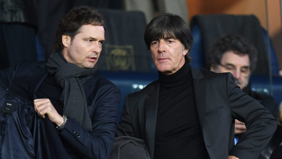 PARIS, FRANCE - MARCH 06:  Germany head coach Joachim Loew (R) looks on from the stand prior to the UEFA Champions League Round of 16 Second Leg match between Paris Saint-Germain and Real Madrid at Parc des Princes on March 6, 2018 in Paris, France.  (Photo by Matthias Hangst/Getty Images)