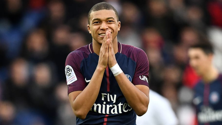 Paris Saint-Germain's French forward Kylian MBappe reacts aftera missing shot on goal during the French L1 football match between Paris Saint-Germain and Metz at the Parc des Princes stadium in Paris on March 10, 2018. / AFP PHOTO / FRANCK FIFE        (Photo credit should read FRANCK FIFE/AFP/Getty Images)